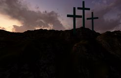 Three Crosses at Sunset. Dramatic sky silhouettes three wooden crosses with shafts of sunlight breaking through the clouds Royalty Free Stock Image
