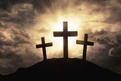 Three crosses symbol on mountain peak Stock Photography