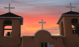 Three crosses at Taos, New Mexico. N old mission in Taos, New Mexico with the sky from a setting sun Stock Image