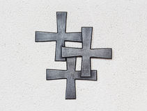 Three crosses on the wall stock photography