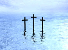 Three crosses over water reflection Stock Images