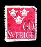 Three Crowns, serie, circa 1939. MOSCOW, RUSSIA - MAY 15, 2018: A stamp printed in Sweden shows Three Crowns, serie, circa 1939 stock images