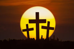 Three crucifixes with a golden sun Royalty Free Stock Photo