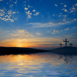 Three crucifixions on hill Stock Photo