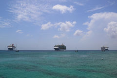 Three Cruise Ships anchors at the Port of George Town, Grand Cayman royalty free stock photography