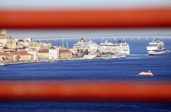 Three Cruise Ships and a Ferry @Lisbon Royalty Free Stock Images