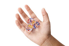 Three crystal dices in kid hand Stock Photography
