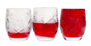 Three crystal wine-glasses with wine Stock Photo