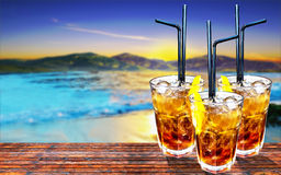 Three Cuba libre exotic tasty cocktail with beautiful mountain s Stock Images