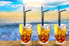 Three Cuba libre exotic tasty cocktail with beautiful sunset ba Royalty Free Stock Photography
