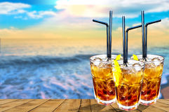 Three Cuba libre exotic tasty cocktail with beautiful sunset bac Stock Photo