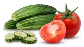 Three cucumber with chopped and whole tomato and one cut in half stock images
