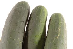 Three cucumbers angle Stock Photos