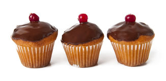 Three cupcake. With chocolate frosting Stock Photo