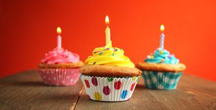 Three cupcake with candles Stock Images