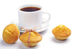 Three cupcake and cup of tea Royalty Free Stock Photo