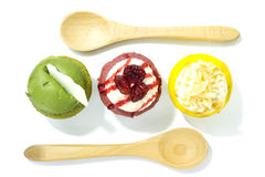 Three cupcake flavor green red and yellow color with spoon on to Royalty Free Stock Image