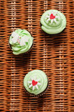 Three cupcakes on a basket Stock Images
