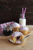 Three cupcakes with blackcurrant jam and coconut Royalty Free Stock Photo