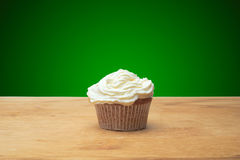 Three cupcakes with candles Royalty Free Stock Image