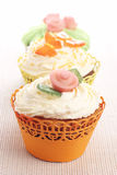 Three cupcakes decorated with marzipan decorations Royalty Free Stock Photos