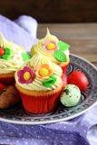 Three cupcakes with eggs on a plate Royalty Free Stock Photography