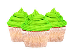 Three cupcakes with green icing Stock Photos