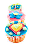 Three cupcakes with marzipan decoration Royalty Free Stock Photos