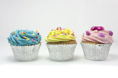 Three cupcakes in a row Royalty Free Stock Photography