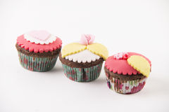 Three cupcakes  on white background Stock Image