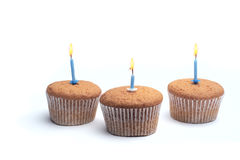 Three cupcakes on a wooden table Stock Photography