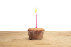 Three cupcakes on a wooden table Royalty Free Stock Images