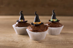 Three cupkaces with witch hat halloween holiday Stock Images