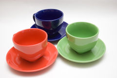 Three cups. Three color cups on the background royalty free stock image