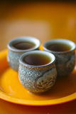Three cups of black tea Stock Photos