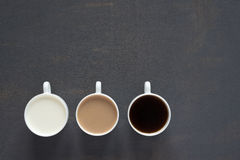 Three cups with coffee and milk Stock Image