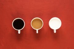 Three cups with coffee and milk Stock Images