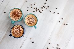 Spending time with three cups of coffee stock images