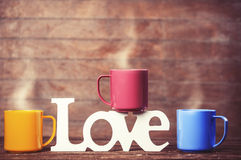 Three cups of coffee and word love Stock Photo