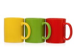 Three cups Stock Images