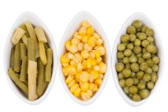 Three cups of corn, green peas and beans Royalty Free Stock Photo