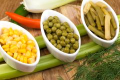Three cups of corn, green peas and beans Royalty Free Stock Images