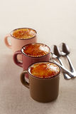 Three cups of creme brulee Stock Image