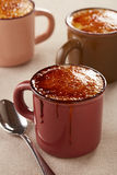 Three cups of creme brulee Royalty Free Stock Photo
