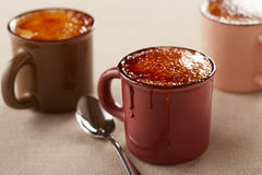 Three cups of creme brulee Royalty Free Stock Photography
