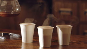 Three cups of delicious coffee on the wooden table stock video footage