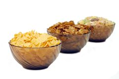 Three cups with different corn flakes Stock Image
