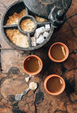 Three cups with ginger tea and rustic sugar-bowl on the wooden t Stock Photos