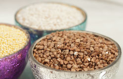 Three cups of grains Stock Photography