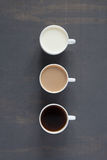 Three cups with milk and coffee Royalty Free Stock Photos